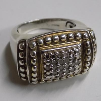 Unusual chunky silver stamped ring set in gold + diamond chips