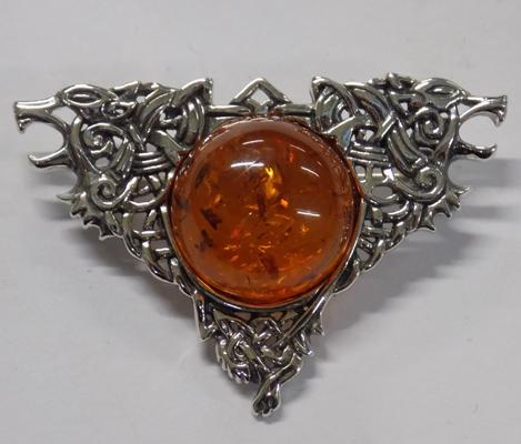 Silver and amber brooch