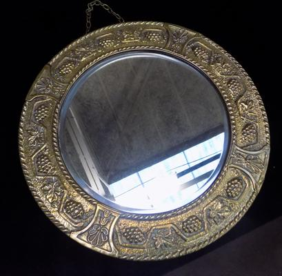 Brass framed round mirror