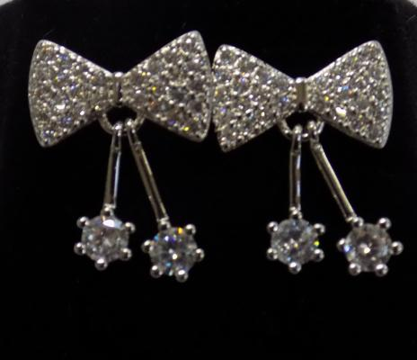 Pair of silver bow and drop earrings