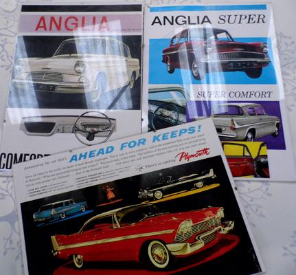Three vintage car advert prints