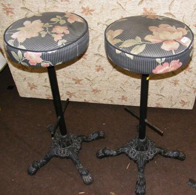 Two heavy cast iron bar stools