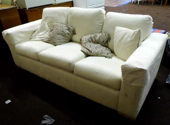 Three seater cream sofa