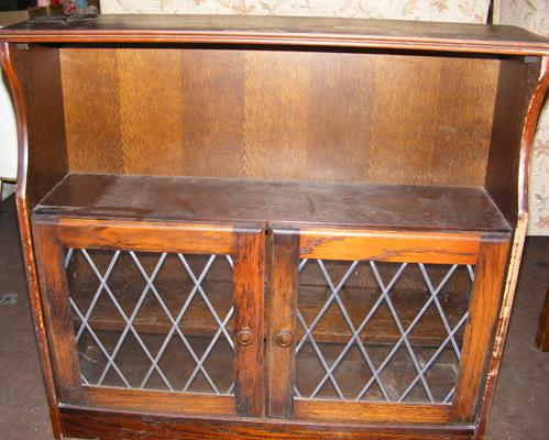Dark wood cabinet with glass doors