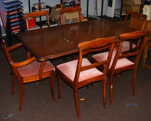 Drop leaf table and 6 mahogany coloured chairs