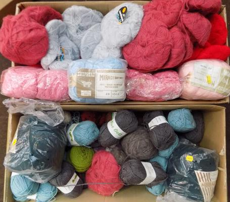 Two large boxes of wool - various colours