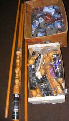 Selection of curtain poles and rings plus box of mix and match curtain rail finals