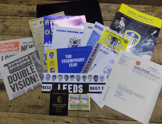 Leeds United Official memorabilia pack 1961-1974, The Don Revie years inc programmes, letters, player cards, newspaper, chips, hat