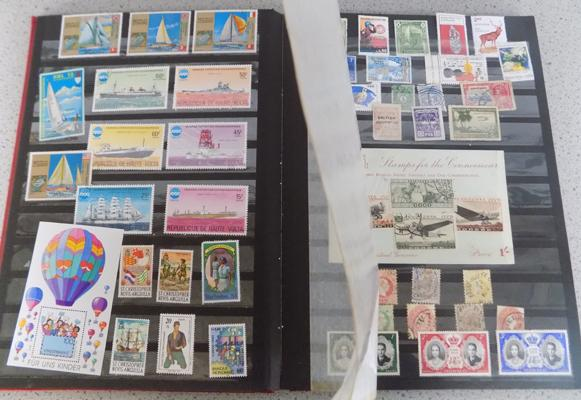 600+ stamps, worldwide, mint & used in 32 side, red stock book