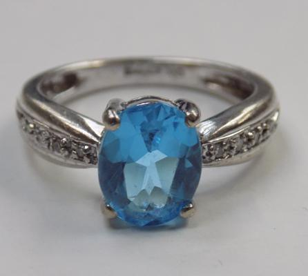 9ct gold diamond and London blue topaz ring - J 1/2