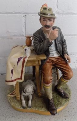 Capodimonte German man and dog (pipe missing)