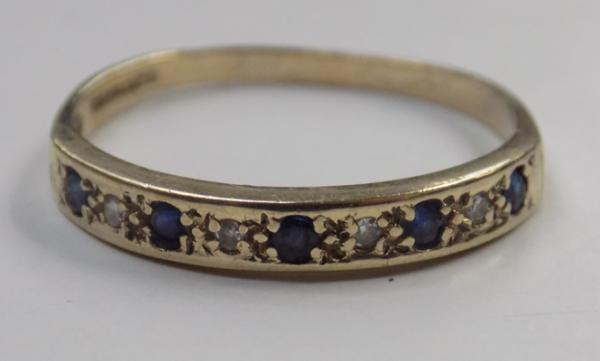 9ct gold diamond and sapphire eternity ring - size Q 1/2
