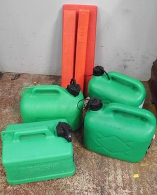 Four plastic fuel containers + three warning triangles