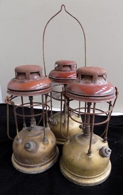 Three Tilley lamps