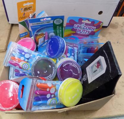 Box of new items including pens, putty etc.