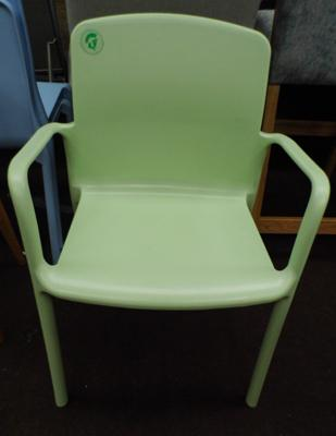 Plastic dining chair with arms, moulded green plastic