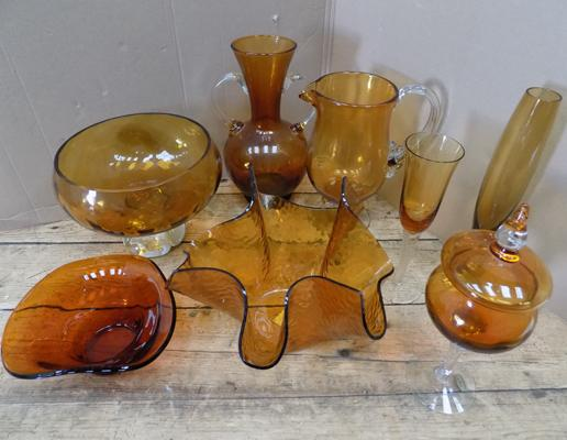 Large assortment of amber glass