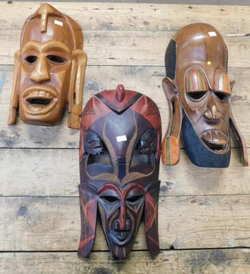 3x African hand carved wooden tribal masks