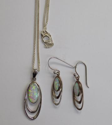 Matching silver earrings and pendant on silver chain