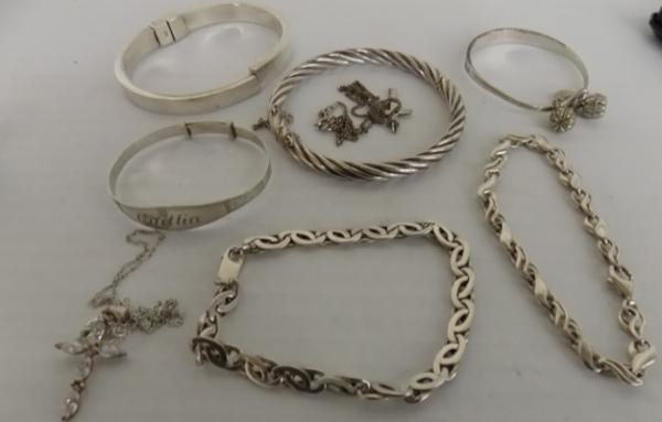 Collection of silver bangles, bracelets etc...