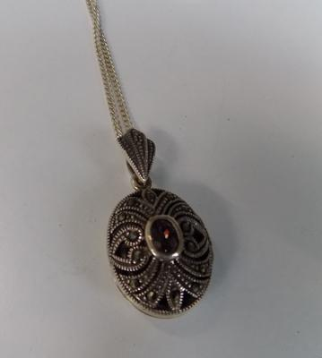 Silver opening locket pendant with marcasite detail  on silver chain (stamped 925)