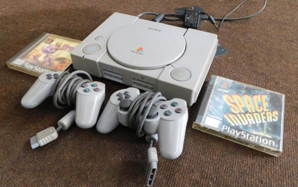Playstation console with game pads etc.