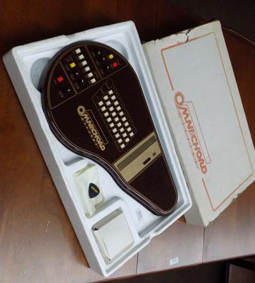 Boxed Suzuki Omnichord OM-27 with instructions