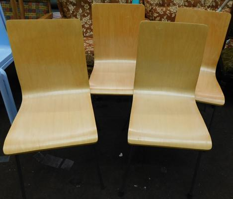 Four plywood chairs with chrome legs