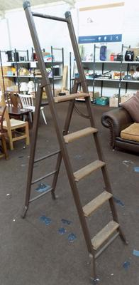 Set of metal stepladders with wooden rungs