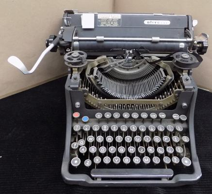 Vintage cast iron Olivetti typewriter in W/O