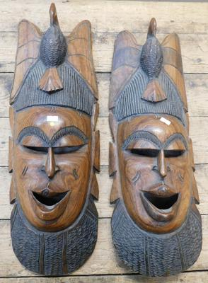 Pair of large African hand carved tribal masks