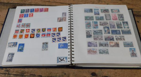 1000s of stamps in 100+ page Worldwide album, mint & used