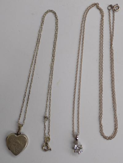2x Silver necklaces with pendants