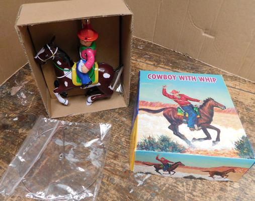Wind-up tinplate cowboy with lassoo
