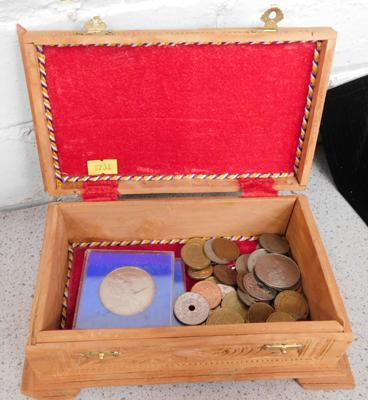 Carved box containing coins