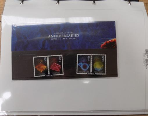 Album of stamp packs - used stamps in presentation packs