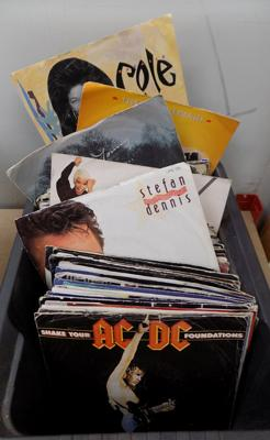 Box of single records inc Doors, AC/DC, Prince, REM etc