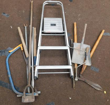 Assortment of garden tools with ladder