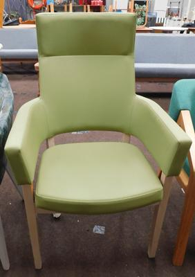 High backed green vinyl chair, new, unused
