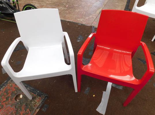 Two moulded plastic chairs, red & white, new, unused