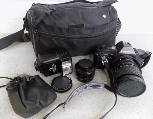 Canon T70 film camera with RMC tokens, telephoto lens, bag & accessories