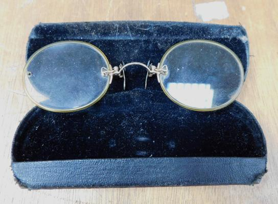 Pair of vintage spectacles in case