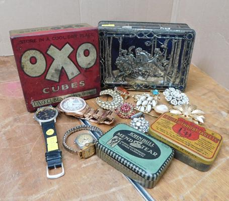 Assortment of vintage brooches and watches and vintage tins