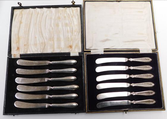 Two boxes of 6 x silver handled butter knives