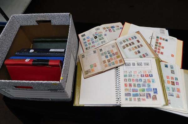 Box containing 13 albums of world stamps