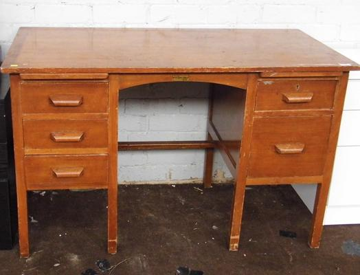 Wooden desk with drawers either side
