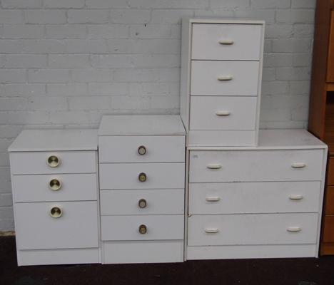 Four sets of white bedroom drawers