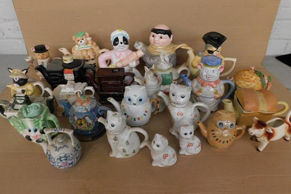Large collection of ceramic novelty teapots inc cow milk jug