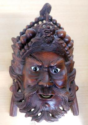 Hand carved oriental wooden wall mask approx 8""