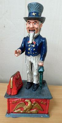 Cast iron Uncle Sam money box, 11 inches